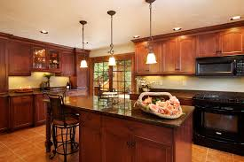 excellent small kitchen design ideas with wooden kitchen island and cabinet storage completed with black oven range and marble countertop plus furnished attractive kitchen bench lighting