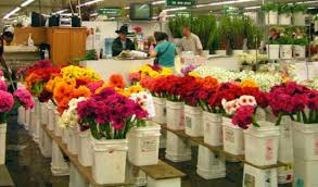 pers at a flower market vendor stall