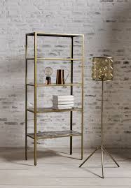 marble and gold shelving unit