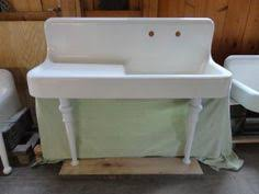 vintage kitchen sink with cabinet white porcelain cast iron and