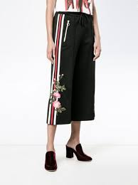 gucci pants. gucci embroidered cropped track pants