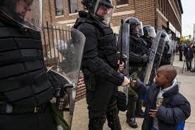 king police brutality fix needs change in systems racial makeup  a young boy greets police officers in riot gear during a in maryland