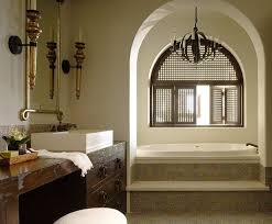 moroccan bathroom design with gold blue tiles soaking tub iron sphere chandelier rustic wood bathroom vanity cabinet washstand with iron ring pulls