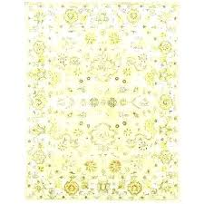light yellow rug and grey round fluffy bright throw