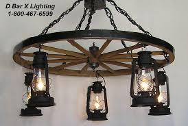 ww026 36 5 36 inch dia single tier rustic wagon wheel chandelier light fixture shown with glossy black finish