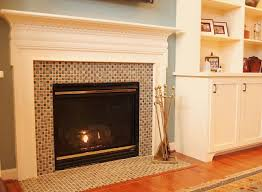 fireplace contemporary mosaic glass tile fireplace surround with concrete carving shelf beside closet wardrobe ideas