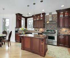 the light floor made of oak wood and plain white walls make the dark cherry cabinets