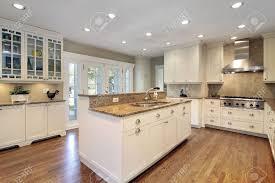 luxury home lighting. kitchen in luxury home with marble island stock photo 6733081 lighting i