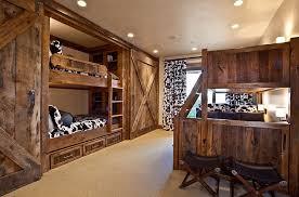 bunk beds and sliding barn doors in the rustic bedroom design mhr design