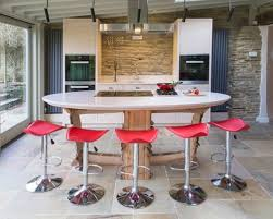Example of a small trendy galley slate floor eat-in kitchen design in  Cornwall with