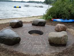 paver firepit with big boulder outcroppings used for sitting around camp fire