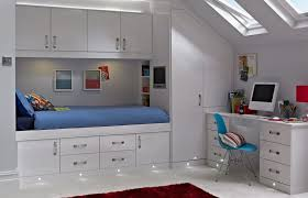 fitted bedrooms. Attractive White Lacquered Fitted Bedroom Furniture With Skylight Bottom  Lamps Also Study Desk And Blue Chair Fitted Bedrooms
