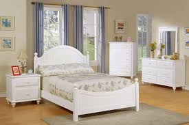 white wooden bed with curved headboard and footboard plus storage cabinet adn side table