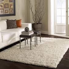 living room room rug ideas square mirror ottomans charming white sofa upholstered stone wall decoration