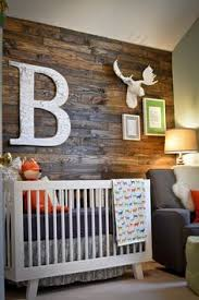 rustic woodland nursery featuring a reclaimed wood accent wall so chic baby nursery rockers rustic