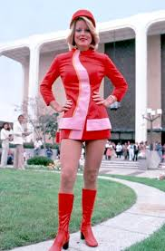 paper dresses and psychedelic catsuits when airline fashion was a flight attendant poses in her pacific southwest airline uniform in 1973 via museum