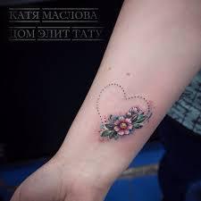 небольшая татуировка на предплечье у девушки по индивидуальному