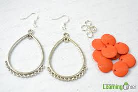 the materials we need are tibetan style links flat round acrylic beads jumprings and earring hooks