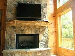 stone fireplace with tv niche installing above can you hang flat screen over mounting plasma brick install abo