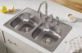 the edges of a top mount sink rest flat on the countertop