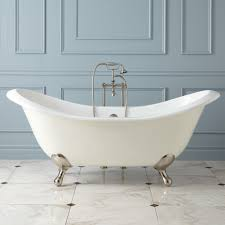 the gretta cast iron clawfoot tub has modern solid brass feet features a substantial size that encourages stretching out and a double slipper