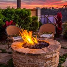 exterior lighting ideas. two chairs romantic set up for sitting outside around a fire exterior lighting options ideas