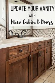 bathroom vanity with dark brown cabinet doors limestone countertop and stone mosaic backsplash with text