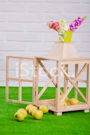 decorative wooden cage with green apples