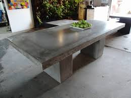 My dinning table is looking pretty much like this one :) outdoor  lightweight concrete table