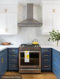 blue and white two tone kitchen cabinets with textured background