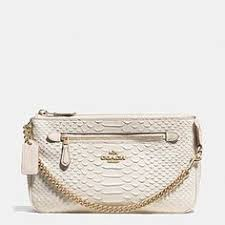 NOLITA WRISTLET 24 IN PYTHON EMBOSSED LEATHER IN WHITE.  Coach