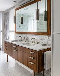 vintage bathroom features mid century modern washstand topped with white and grey marble bathroom vanity barnwood mirror oyster pendant lights