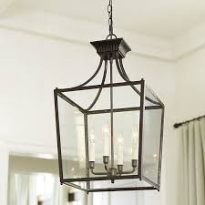 combine traditional beauty with modern convenience in this ashley bronze 4 light foyer hanging lantern