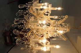 beautiful maria teressa 16 light crystal chandelier measures 28 inches wide about the same height cost over 2 000 and is in perfect condition