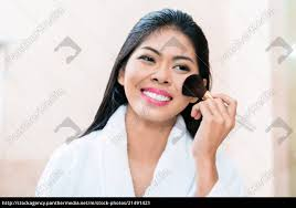 royalty free image 21491421 asian woman in applying makeup
