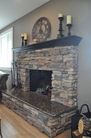 love this fireplaces stone granite could stone the bottom half like this then sheetrock the portion over the mantle and paint an accent color