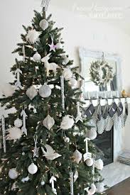 ... all white Christmas tree with diy wooden arrow ornaments | 4men1lady  for Remodelaholic.com