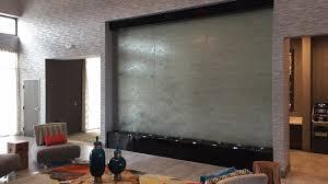 custom water wall indoor glass lobby waterfall holiday inn houston texas you