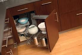 swing out wire baskets in a corner storage cabinet from dura supreme cabinetry