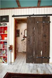 put this barn door hardware on an angle and cut down an oversized door the same way and you have a pseudo fire door giving your humble abode an industrial