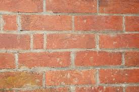 closeup photo of an old red brick wall free background texture