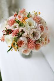 stunning peachy pink wedding bouquet with juliet charity and patience from the david austin