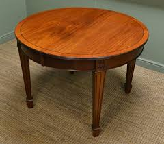round extending dining table antique