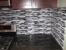 image of installing glass tile backsplash