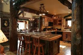 distinctive black antler rustic pendant lighting over kitchen island with 3 log wood counter height chairs