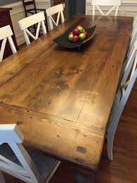 reclaimed wood dining table with a 2 thick plank top breadboards and custom