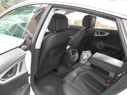 audi a7 interior back seat. at first the a7 feels like a typical large audi with somewhat light steering low speeds and good sight lines instrument panel is nice clear interior back seat d