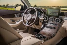 It's swathed in trim that flows down from the center display screen, in a wood or metallic waterfall. 2019 Mercedes Benz Glc Class New Car Review Autotrader