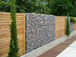 fence panels designs. Ideas For Garden Fencing: Fence Of Natural Stone And Wood Panels Designs 8