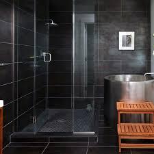 black mosaic shower floor tile ideas